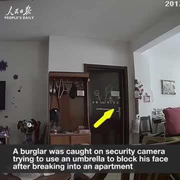 Umbrella can't make you invisible- Burglar caught blocking security cam w umbrella after breaking in