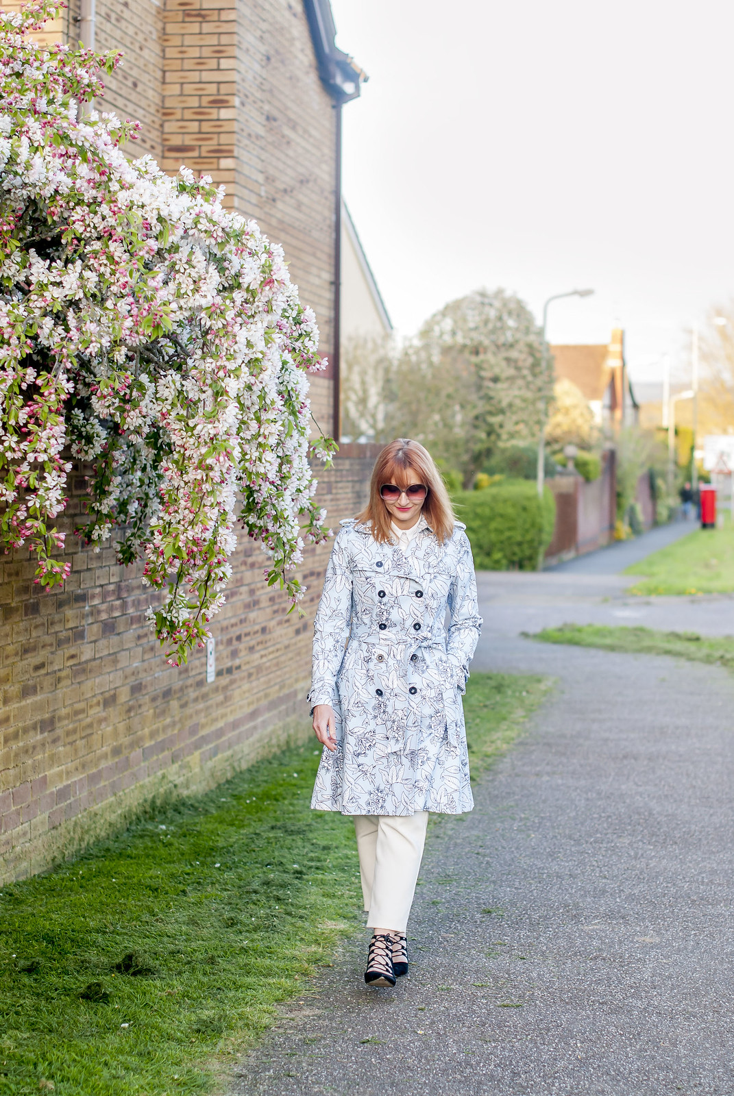 Spring fashion: Blue floral trench coat white trousers black lace-up ghillie shoes oversized 70s sunglasses | Not Dressed As Lamb, over 40 style