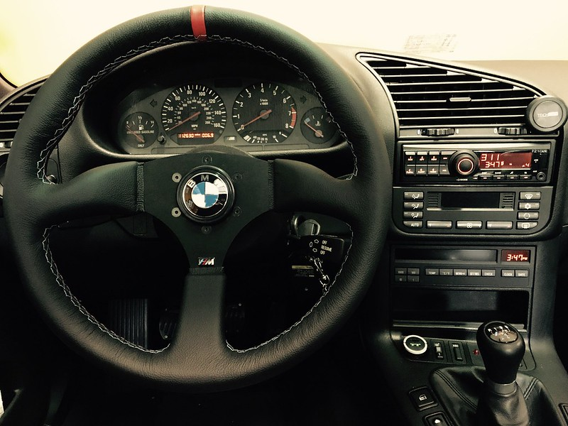 ... The Interior And Went With A Renown Steering Wheel W. M Tricolor Stitch  W. OEM Horn, Clarion Headunit, ZCP Shift Knob, And CF Glove Box Trim.