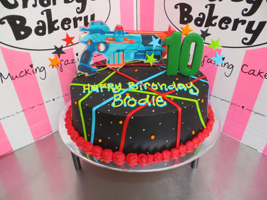 Laser Tag Themed Cake Iced In Black Chocolate Ganache With