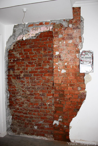 Looking at what lies beneath to find the cause for the crack reveals two coliding walls.