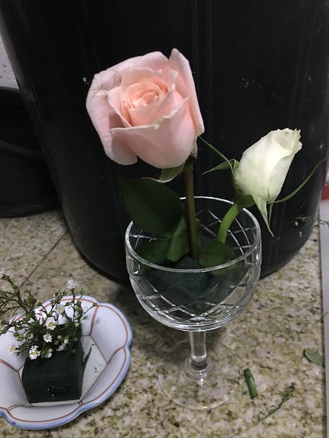 wine goblet, two roses