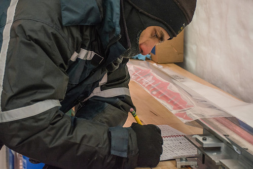 Murat Aydin records information about an ice core he processed | by U.S. Ice Drilling