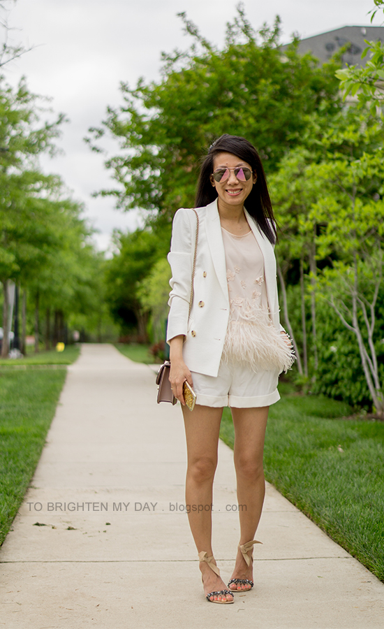 white blazer, nude top with feathers, white shorts, nude shoulder bag, suede sandals with jewels