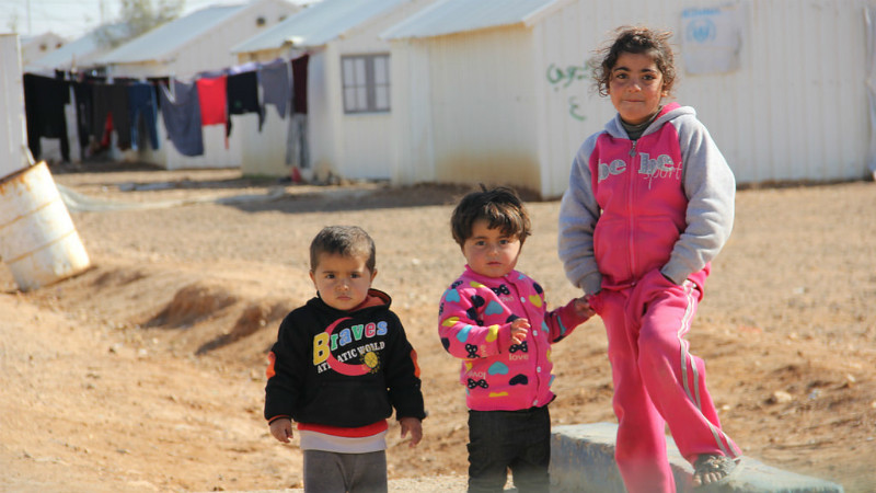 Three children in a refugee camp in Jordan.