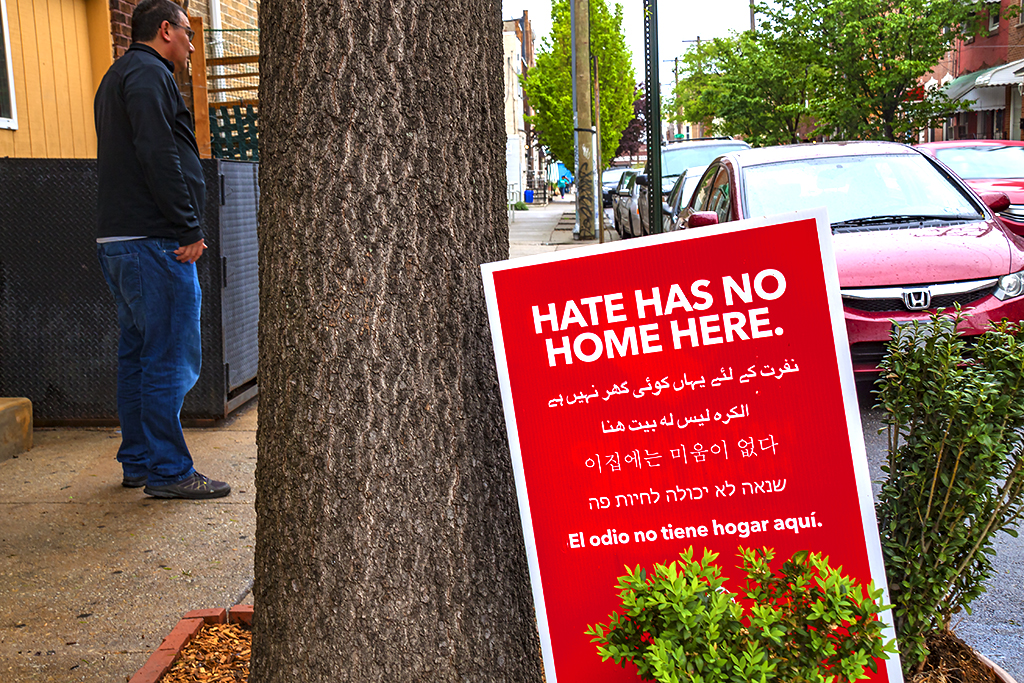 HATE HAS NO HOME HERE sign outside laundromat--Italian Market