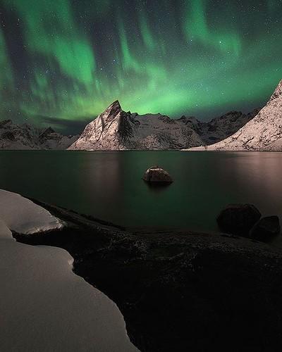 Northern lights show in Reine, Lofoten, Norway.
