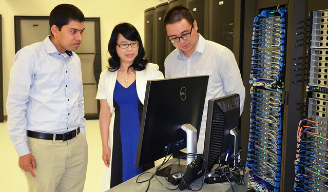 Sanjiv Kumar, Susan Pan and Jia Yang use Auburn's supercomputer to run climate model simulations.