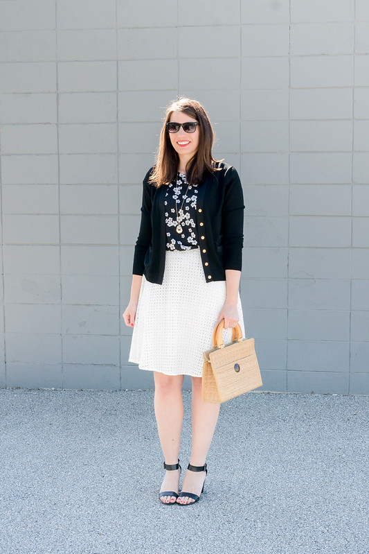 white eyelet skirt + black floral tee + black J.Crew cardigan + wicker straw bag + Target black heel sandals | Style On Target blog