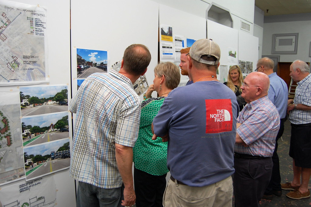 Visitors and Stantec staff look over idea boards