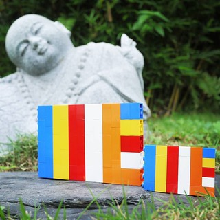 On #Vesak Day, Buddhists celebrate the birth, enlightenment and death of Lord Buddha. The #Buddhist #flag comprises the colours blue (compassion), yellow (balance), red (virtue), white (purity) and orange (wisdom), and together they represent the universa | by www.artisanbricks.com