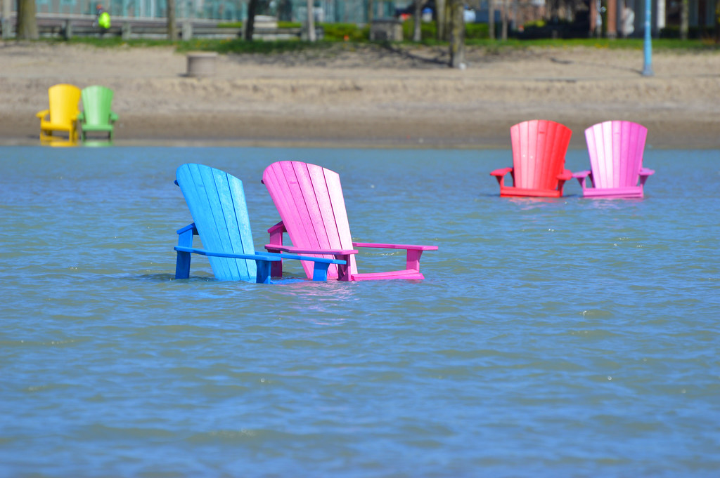 adirondack chairs on beach. Colourful Muskoka / Adirondack Chairs In Floodwaters. Woodbine Beach . On