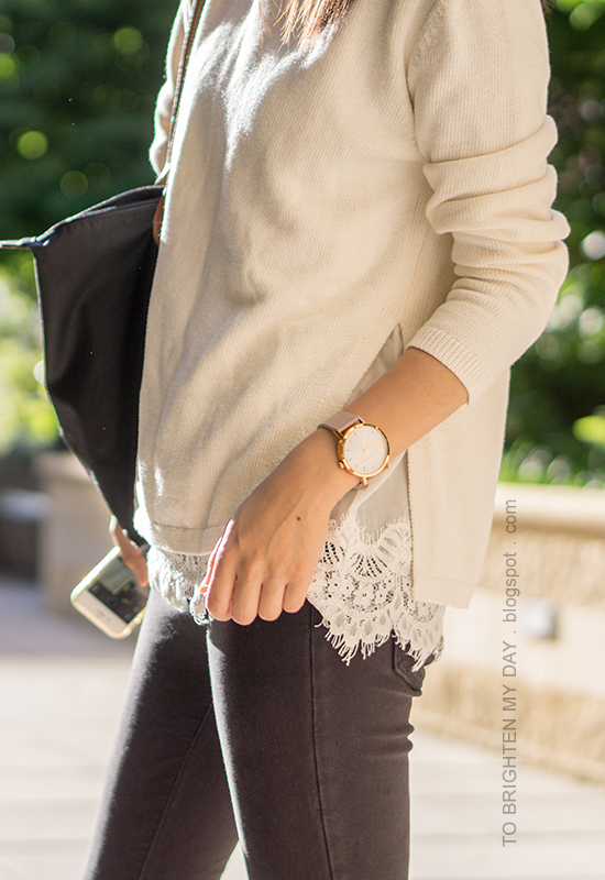white sweater with lace hem, oversized watch, black skinny jeans