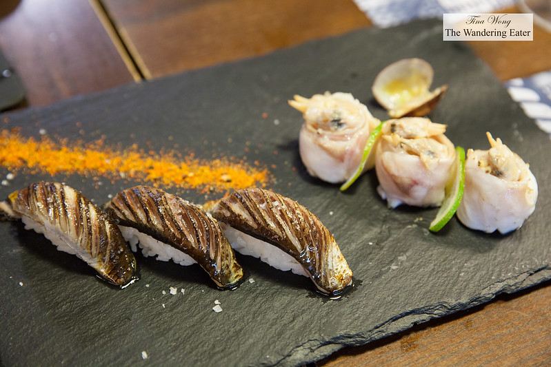 Plate of blowtiorched sardine nigiri with togarashi and clam & sea bass maki