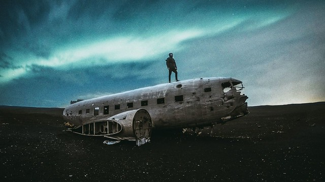 Northern Lights and a plane wreck (By Nicolas Zimmermann i)