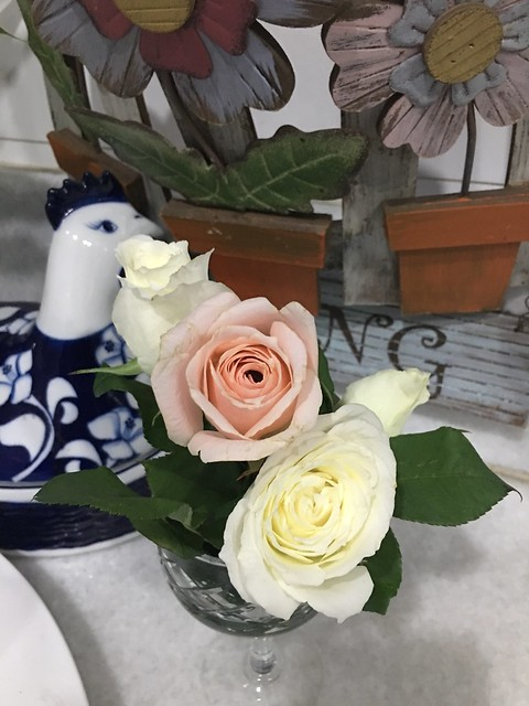 wine goblet,  floral arrangement
