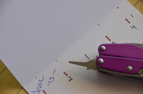 2. Start punching 4 holes into every card, using the template