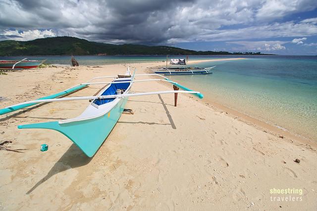 the long white sand  beach at Logbon Island