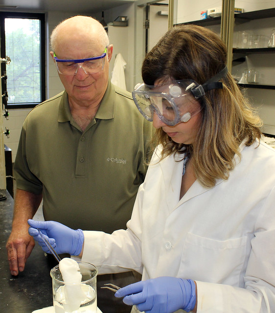Dave Worley and Buket Demir work with gauze in a lab.