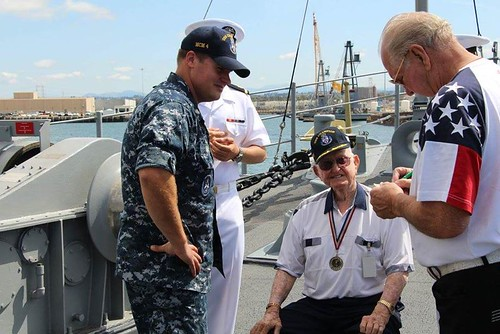 SAN DIEGO - Lt. Cmdr. Joseph Burgon, commanding officer of USS Champion (MCM 4), welcomes WWII Veteran and former minesweeper Sailor Bill Harrison. This was Harrison's first time back on a minesweeper in more than 70 years!