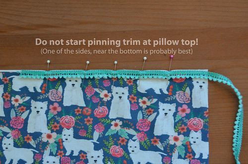 6b. Do not start pinning trim at the top of the pillow!
