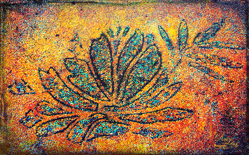 Image of a cement leaf on a walkway at the Ormond Memorial Gardens
