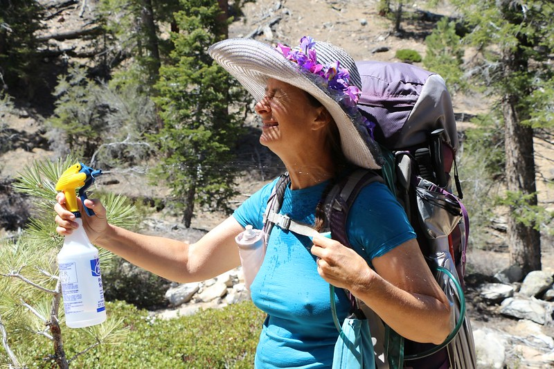Vicki tries out our new hot-hiking experiment - a water sprayer to keep her cool in the sun