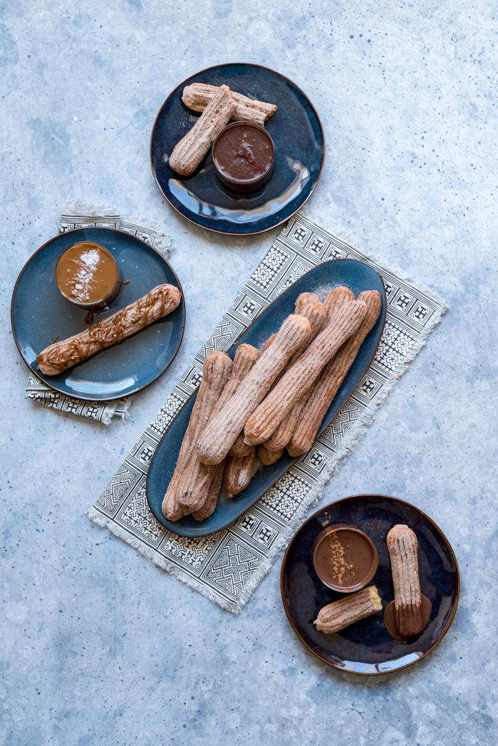 Baked Churros with three dipping sauces #AD #DiscoverWorldMarket  www.pineappleandcoconut.com