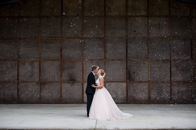A kiss captured on a rainy day on the stage of the amphitheater at Pocahontas State Par. Photo credit: Amber Kay Photography