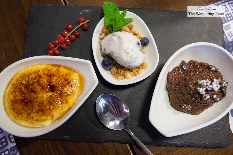 Trio of desserts - Bruleed custard, blueberry ice cream with cake crumbles, chocolate mousse