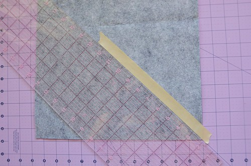 1. Use 45-degree lines on cutting mat to place masking tape at 45 degree angle of felt corner.