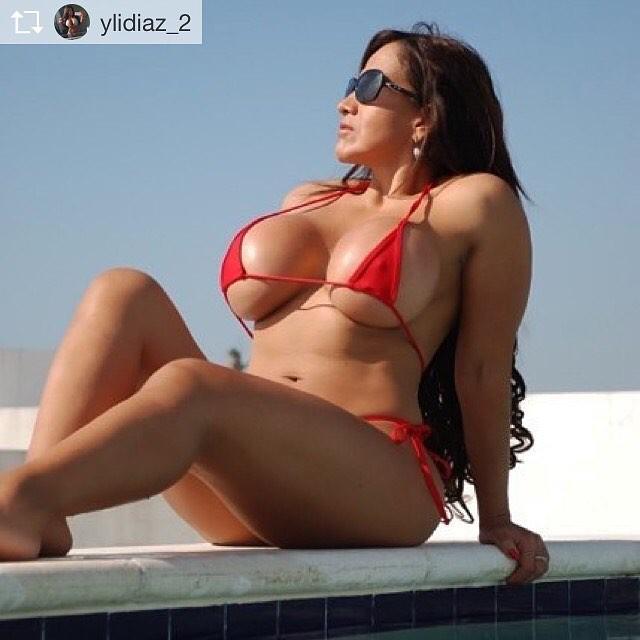Latina in bikini by a pool
