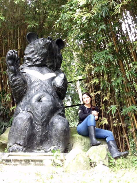 Volunteer Mary Robles and bear statue at CBRC