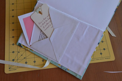 35. Glue envelopes to endpapers, if desired.
