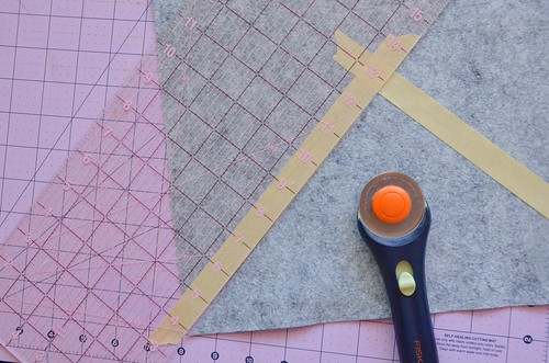 3. Use rotary cutter & acrlyic guide to cut along the masking tape line.