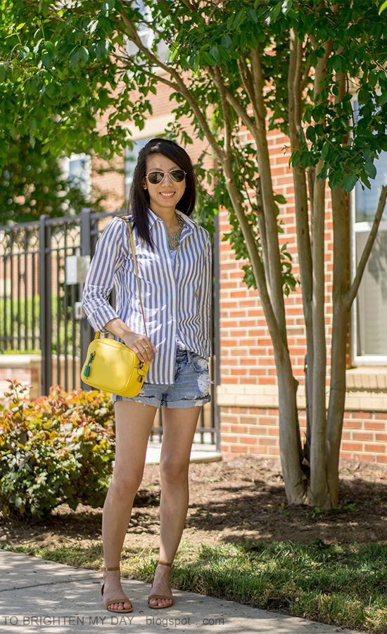 blue striped button up shirt, turquoise statement necklace, distressed shorts, yellow camera bag, brown suede sandals