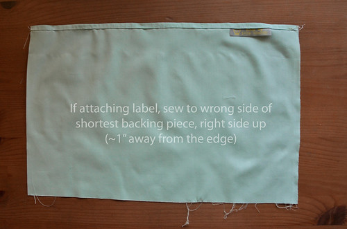 4. If adding a sew-in label, should be pinned in now, on the wrong side of the [shorter] backing fabric.