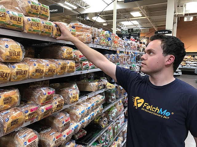 Auburn student Harrison Evola reaches for a loaf of bread.