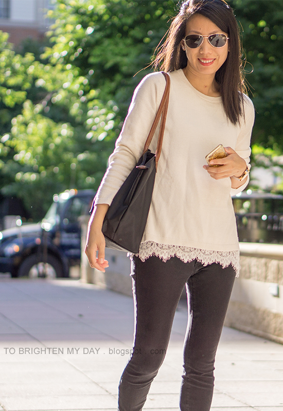 white sweater with lace hem, oversized watch, black skinny jeans, black tote