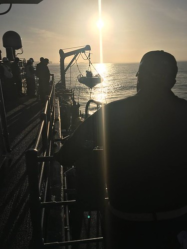 Sailors on board USS Ardent (MCM 12) conduct small boat operations at dawn while Ardent's commanding officer, Lt. Cmdr. Samuel Hoard Jr., observes to ensure the evolution is conducted safely.