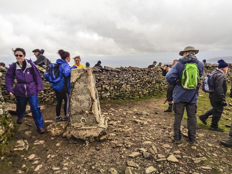 A busy Whernside summit trig point
