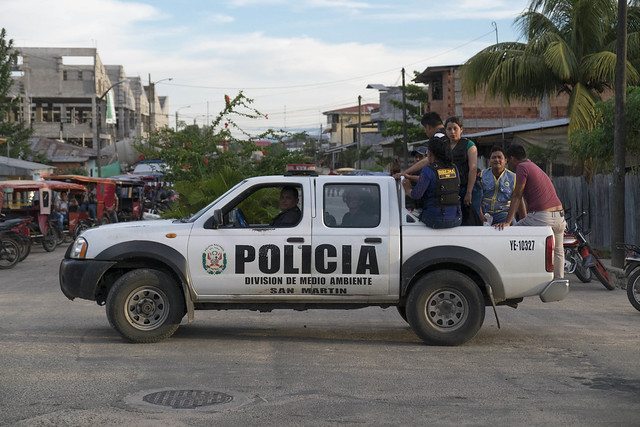 police truck with people sitting on it