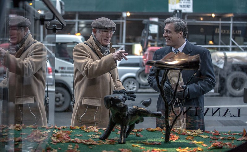 Richard Gere and Lior Ashkenazi don't know how prescient that dog is in NORMAN: THE MODERATE RISE AND TRAGIC FALL OF A NEW YORK FIXER.