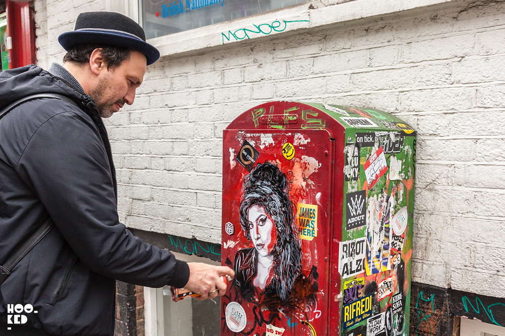 French Street Artist C215 working on an Amy Winehouse portrait