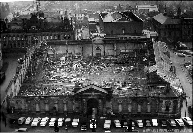 Looking down on demolition work from the top of St Peter's church in January 1961. In the background, left can be seen the Town Hall.