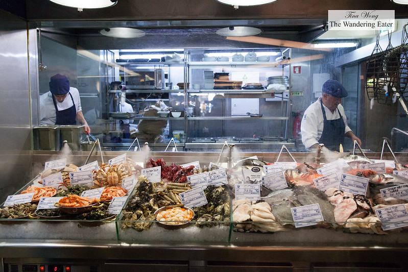 Large seafood display in front of the kitchen, priced per kg