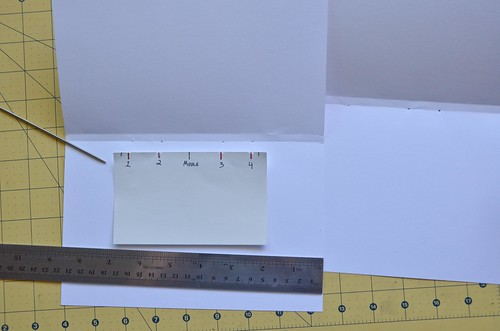 16. Use hole punch guide to punch holes into folded card stock.