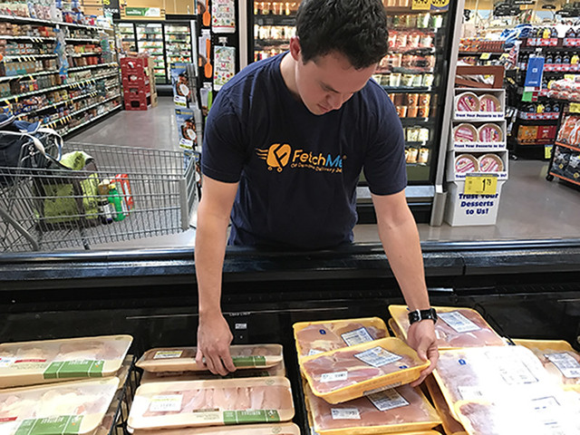 Auburn student Harrison Evola reaches for meat products.