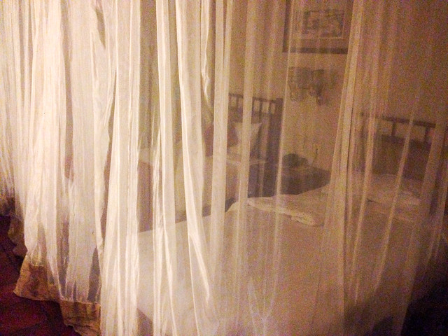 Mosquito netting around a bed in Uganda