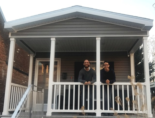 Claudia and Garrett on the Steps of Their Tiny Home